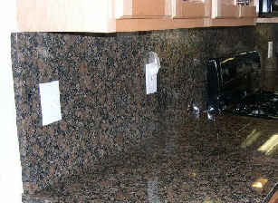 full height granite backsplash